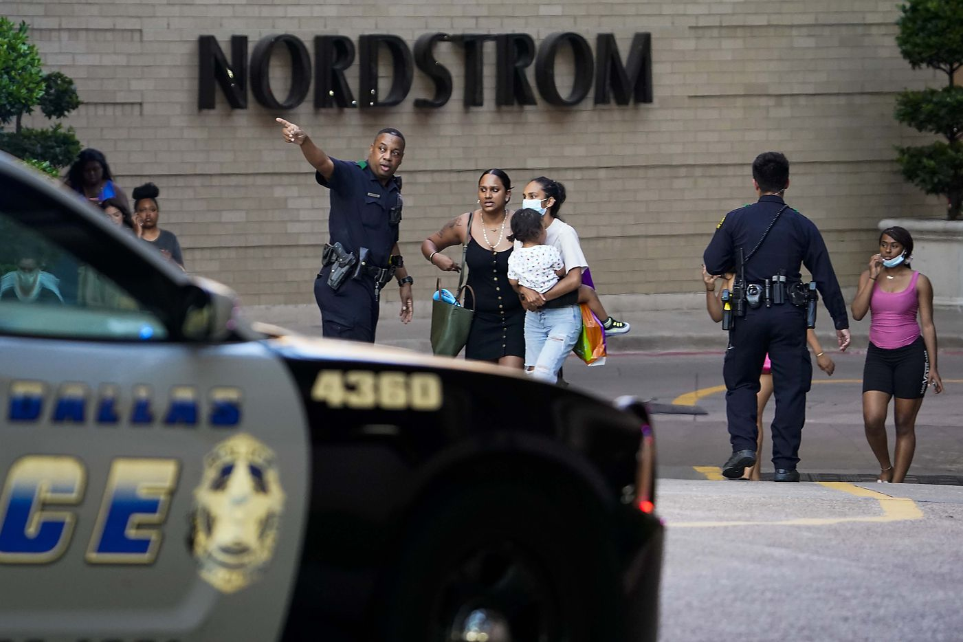 Dallas police direct people away from the Nordstrom store at the Galleria Dallas on Tuesday, June 16, 2020, in Dallas. One person was wounded as shots rang out at the Galleria Dallas mall on Tuesday evening, sending panicked shoppers running for stairwells and freight elevators. Dallas police said hours later that two males, in their teens or early 20s, had gotten into an argument that ended with one of them shooting the other just before 6:45 p.m. in the Far North Dallas mall's food court.