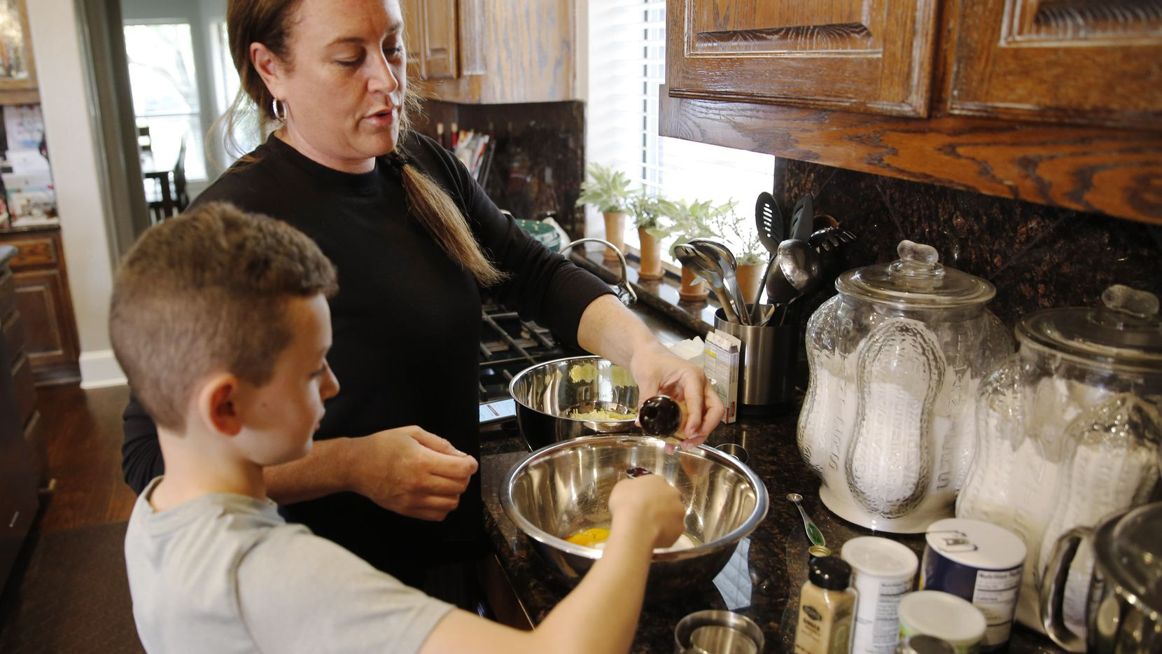 """Jamie Heit used a zucchini muffin-making session at her Frisco home as a chance to work with her 10-year-old son, Brandon, on measurements and fractions. She said last weekend was when her family """"pulled back the reins and began wondering what would happen with daily life."""""""