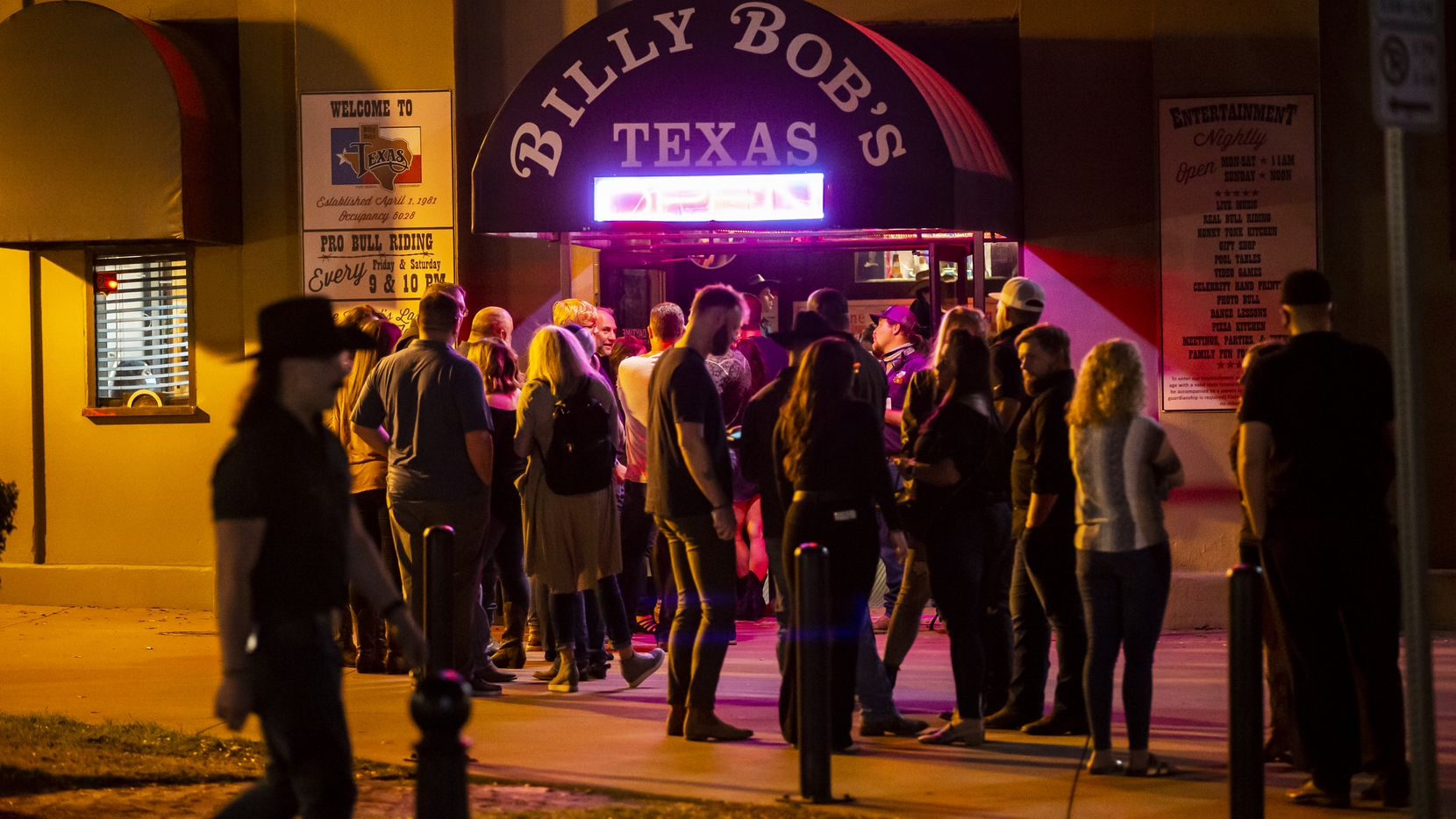 Patrons, largely without masks, line up to enter Billy Bob's Texas in Fort Worth, Friday, March 12, 2021. Aaron Lewis performed Friday night, the first weekend concert at Billy Bob's since the mask mandate was lifted.