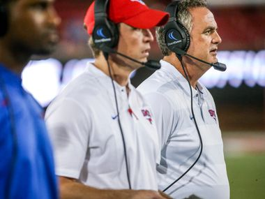 Southern Methodist Mustangs head coach Sonny Dykes looks on along with his coaching staff during the first half of an NCAA football game between Southern Methodist Mustangs and Houston Baptist on Saturday, September 29, 2018 at Ford Stadium in Dallas.