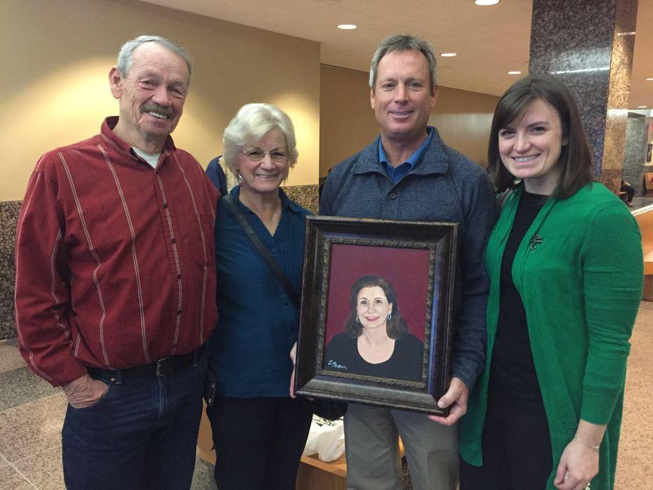 Joe Brown, Lorraine Brown, Don Martin and Caitlin Martin-Linduff with a painting of Kellie Martin. (Caitlin Martin-Linduff)