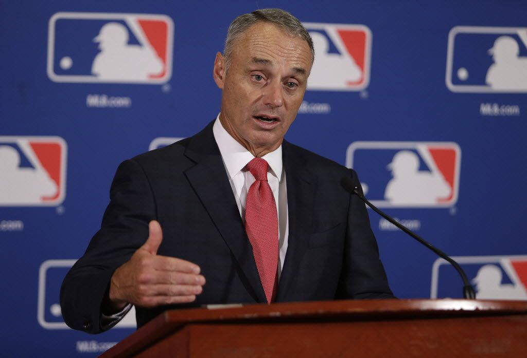 Major League Baseball commissioner Rob Manfred speaks to reporters following morning meetings with the baseball owners in Houston, Thursday, Aug. 18, 2016. (Mark Mulligan/Houston Chronicle via AP)