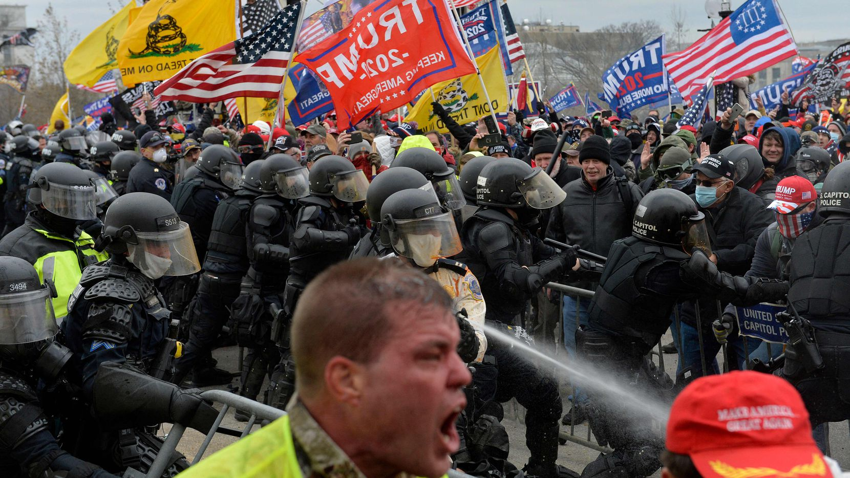 Trump supporters clash with police and security forces as people try to storm the Capitol on Jan. 6, 2021.