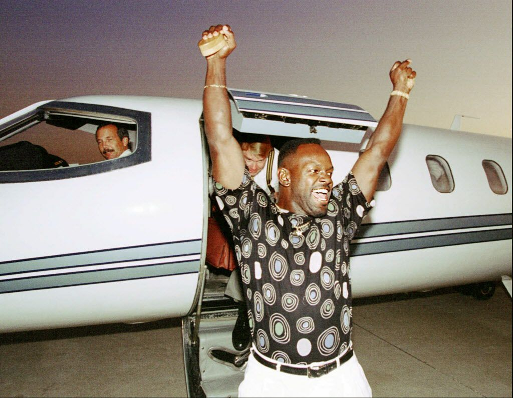 "Dallas Cowboys running back Emmitt Smith proclaims ""It's great to be back in Dallas!"" after deplaning from Cowboys owner Jerry Jones' jet at DFW airport Thursday night, Sept. 16."
