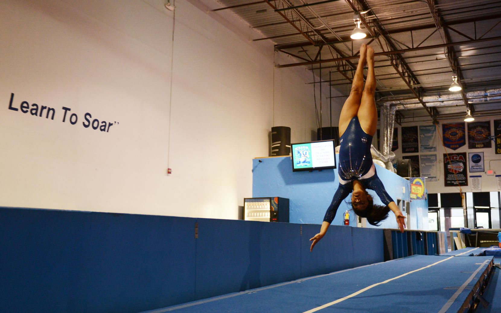 In a 2013 file photo, Hope Bravo practiced her tumbling routine at Eagle's Wings Athletics in Allen before competing in the 2013 World Trampoline and Tumbling Championships in Sofia, Bulgaria.