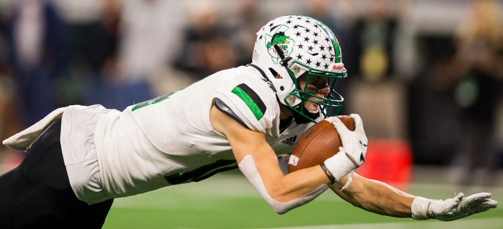 Southlake Carroll running back Owen Allen (4) dives toward the end zone for a touchdown during the second quarter of a Class 6A Division I area-round high school football playoff game between Southlake Carroll and DeSoto on Friday, November 22, 2019 at AT&T Stadium in Arlington. (Ashley Landis/The Dallas Morning News)