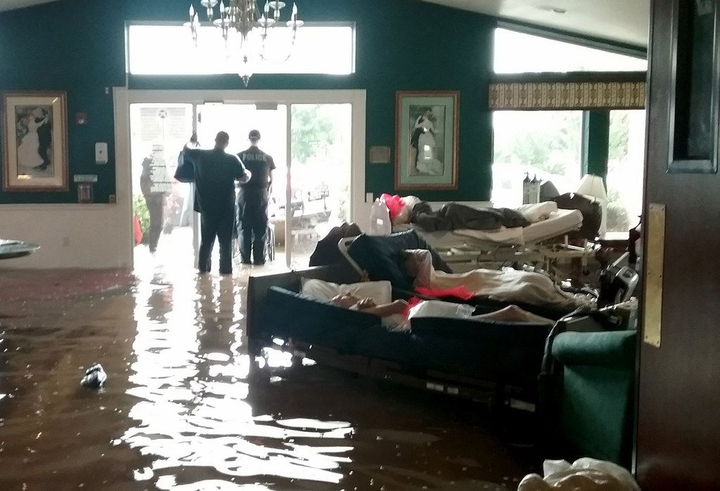 Residents lie on sofas while waiting to be evacuated from the Cypress Glen senior care facility in Port Arthur, which was inundated with water from Hurricane Harvey.