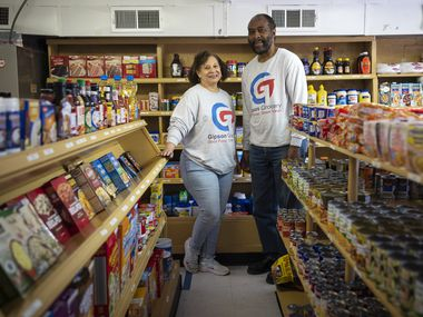 Co-owners Jonnie Gipson and Phillip Gipson stand inside their business Gipson Grocery in Dallas. The small neighborhood grocery store is one of the longest-running Black-owned grocery stores in North Texas and the nation.