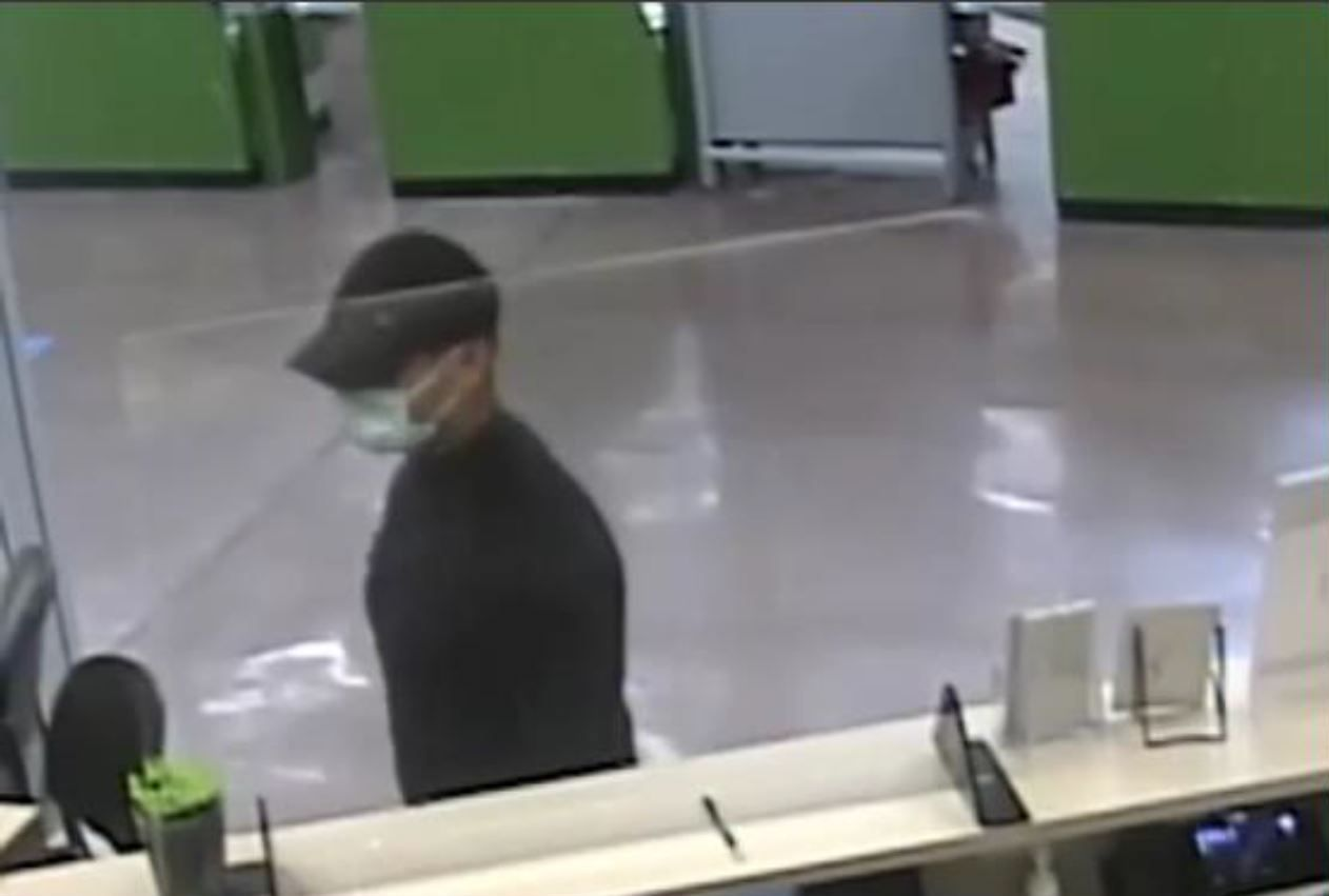 The robber flashed a weapon after approaching a teller, police said.