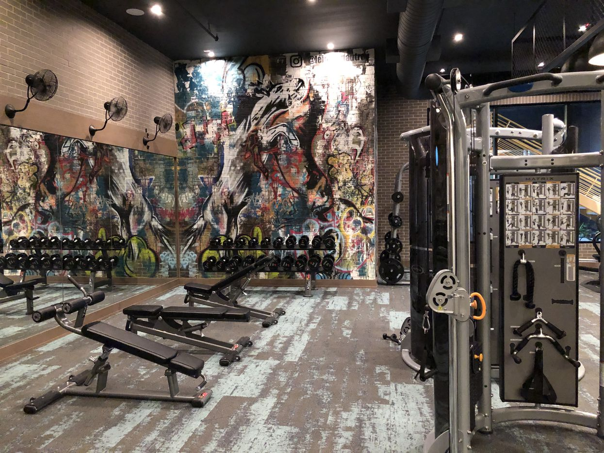The gym in the Novel Deep Ellum apartments features a mural by local artists.