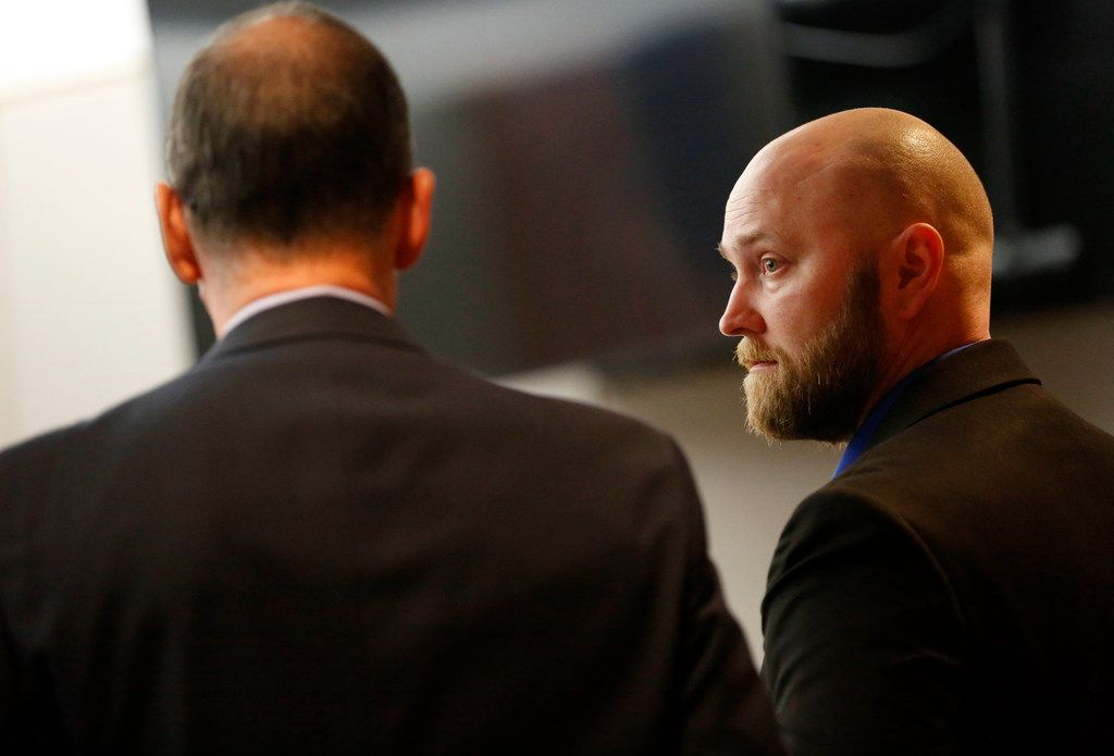 Roy Oliver (right) spoke with defense attorney Bob Gill after a hearing to delay his trial, at the Frank Crowley Courts Building in Dallas on Thursday.
