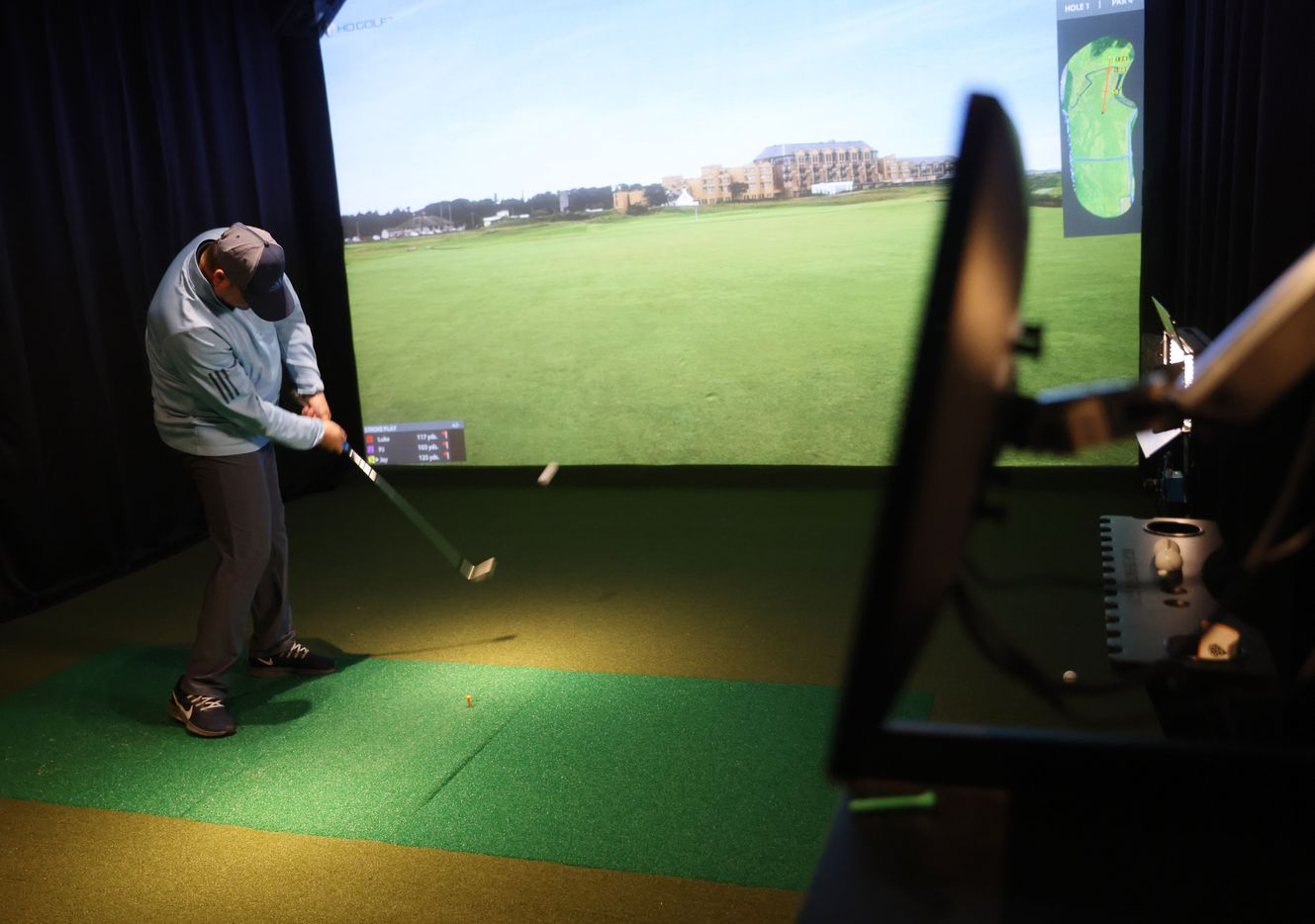 Jay Bivin plays virtual golf in one of five simulators at Daylight Golf on Thursday, January 21, 2021in Grapevine, Texas.