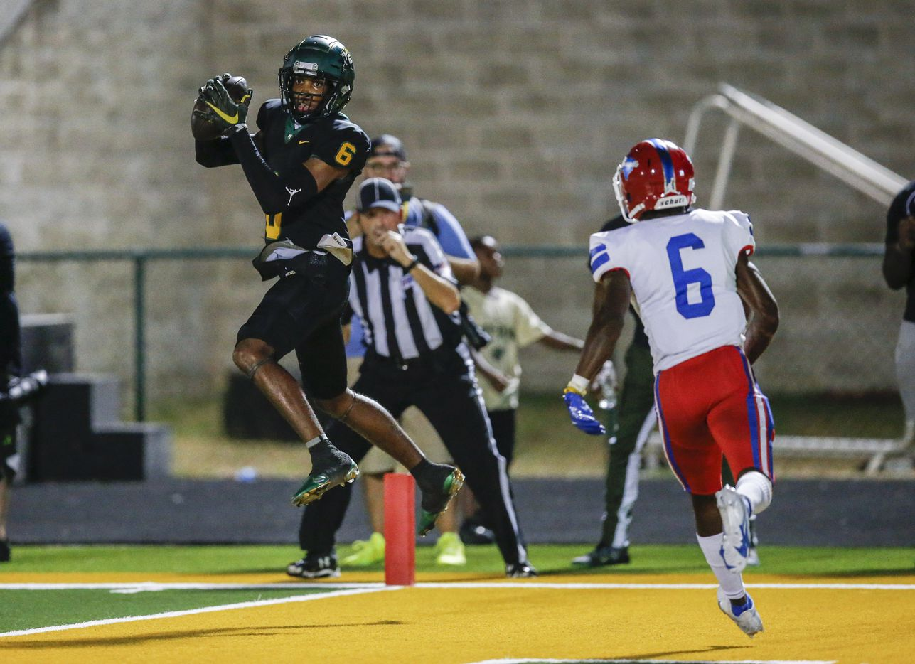 Duncanville senior defensive back Da'Myrion Colemman (6)(CQ) looks on as DeSoto senior wide receiver Stephon Johnson Jr. (6) catches a pass for a touchdown during the first half of a high school football game at DeSoto High School, Friday, September 17, 2021. (Brandon Wade/Special Contributor)