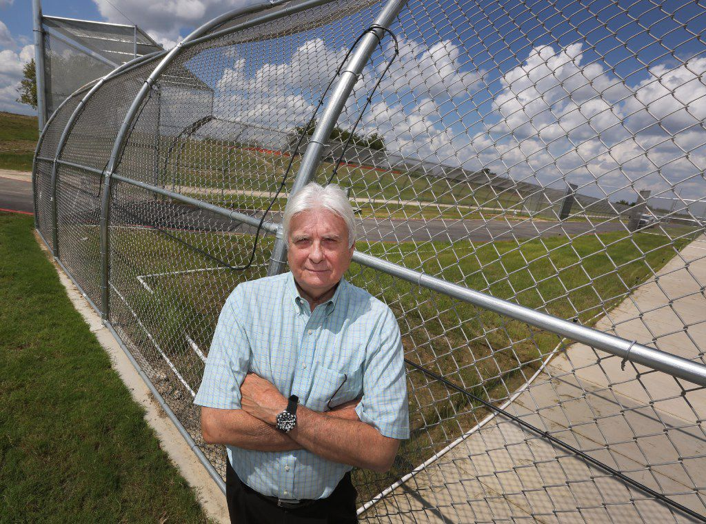 Emerald CEO Steve Afeman outside the new Prairieland Detention Center in Alvarado, with special fencing that deters escape. (Louis DeLuca/The Dallas Morning News)