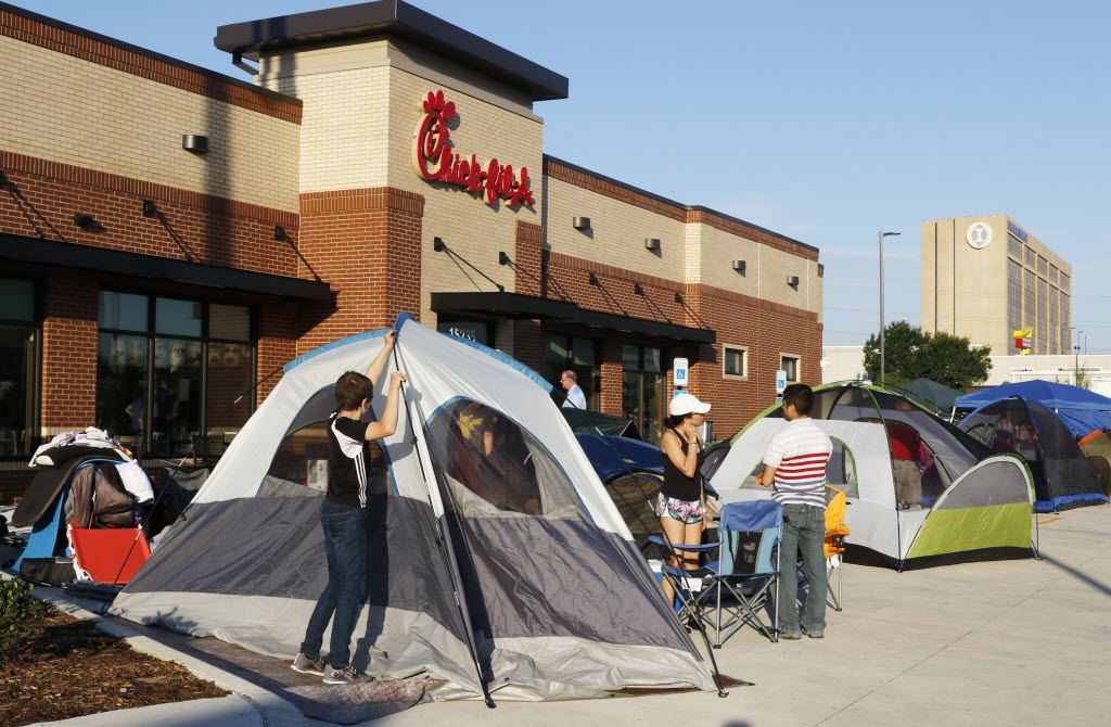 Grayson Ireland, 14, of Allen, helps pitch his tent. He's in line with his mother in hopes of receiving one Chick-fil-A Meal per week for a year at the grand opening of Chick-fil-A in the 15200 block of Montfort Dr. in Dallas.