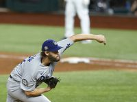 Los Angeles Dodgers starting pitcher Clayton Kershaw (22) pitches in a game against the Tampa Bay Rays during the sixth inning of game five of the World Series at Globe Life Field on Sunday, October 25, 2020 in Arlington, Texas.