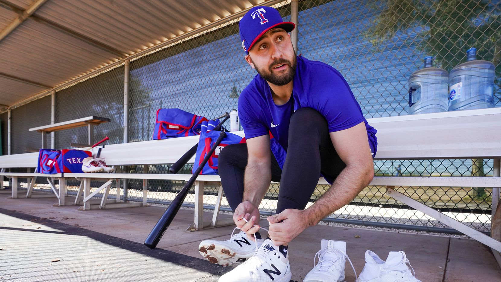 Texas Rangers outfielder Joey Gallo laces up his cleats before taking batting practice during a spring training workout at the team's training facility on Friday, Feb. 14, 2020, in Surprise, Ariz.