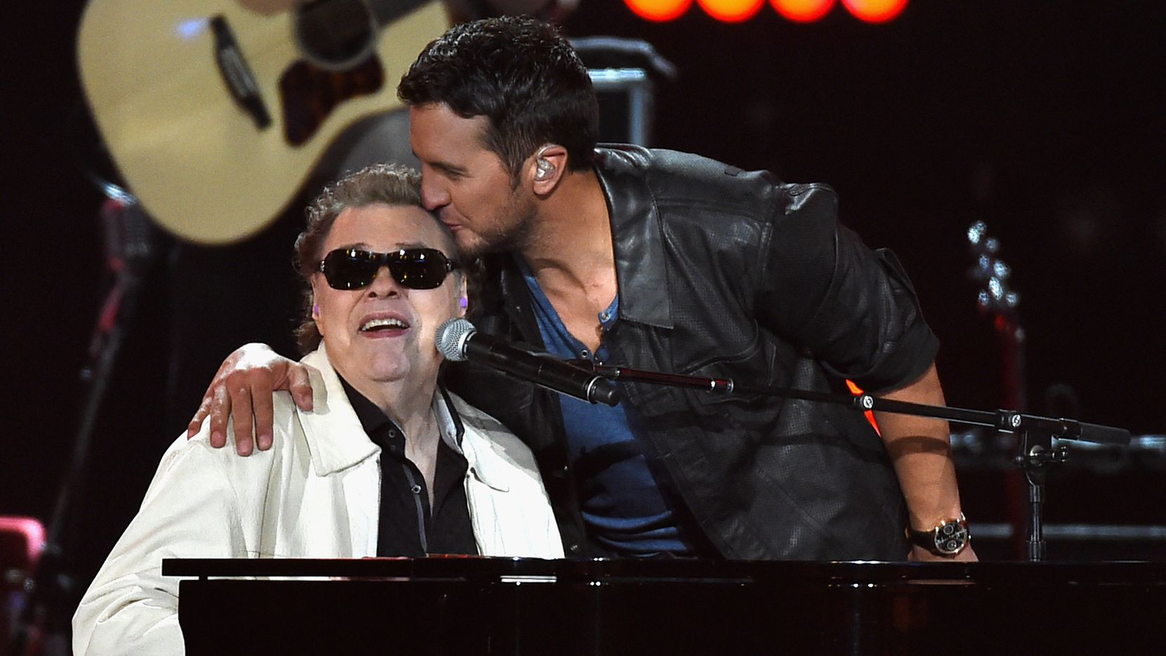Singers Ronnie Milsap (left) and Luke Bryan perform onstage during ACM Presents: Superstar Duets at Globe Life Park on April 17, 2015 in Arlington, Texas.