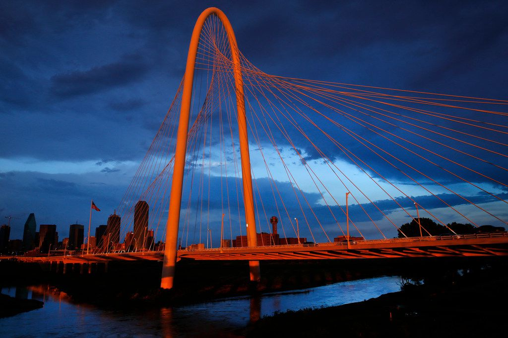 The setting sun illuminates the Margaret Hunt Hill Bridge and downtown Dallas after thunderstorms rolled through the middle of the Dallas-Fort Worth on Wednesday evening.