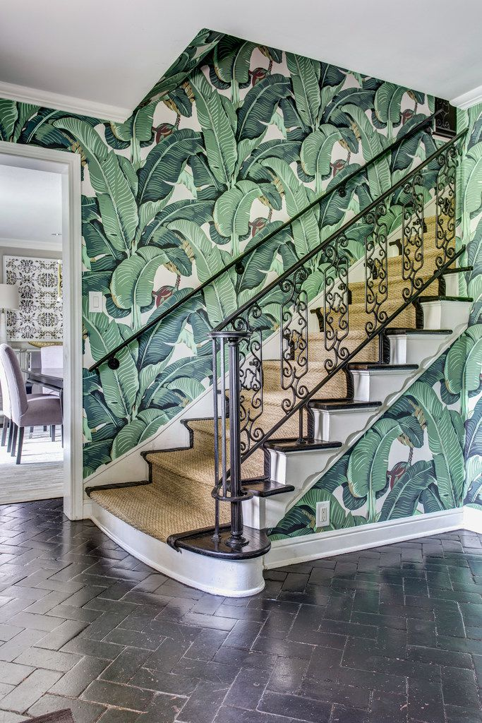 The tropical print wallpaper hints at the rest of this Dallas home's unique furnishings and style, says Emily Johnston Larkin of EJ Interiors.