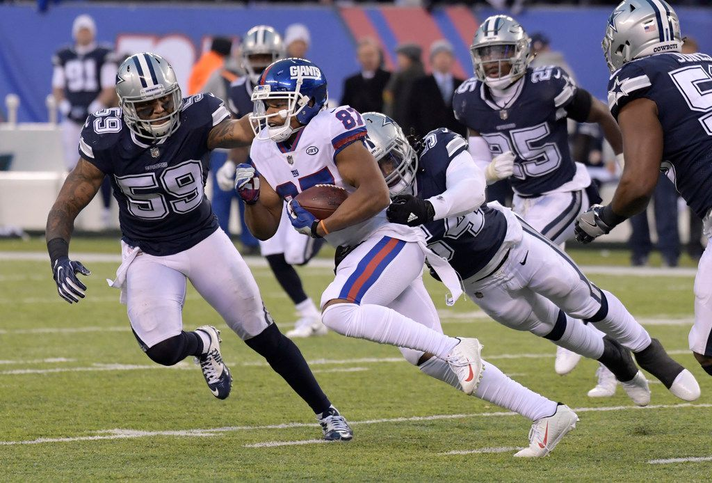 New York Giants wide receiver Sterling Shepard (87) is pursued by Dallas Cowboys linebackers Anthony Hitchens (59) and Jaylon Smith (54) during the second half of an NFL football game, Sunday, Dec. 10, 2017, in East Rutherford, N.J. (AP Photo/Bill Kostroun)