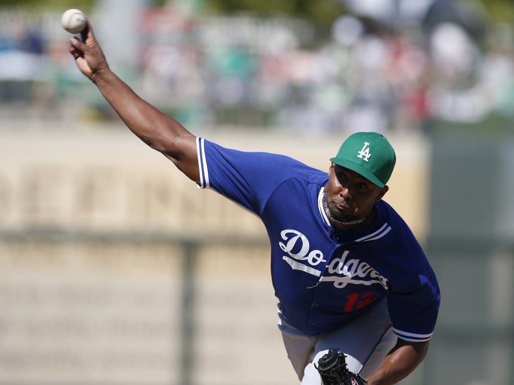 Mar 17, 2015; Surprise, AZ, USA; Los Angeles Dodgers starting pitcher Juan Nicasio (12) throws in the fourth inning against the Texas Rangers during a spring training game at Surprise Stadium. Mandatory Credit: Rick Scuteri-USA TODAY Sports
