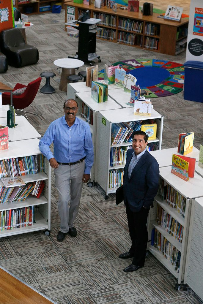 "The Coppell school board soon will have its first Indian American trustee — either Balkishore ""Balki"" Chamkura (left) or Manish Sethi. On Monday, they posed in the library of Richard J. Lee Elementary near DFW Airport."