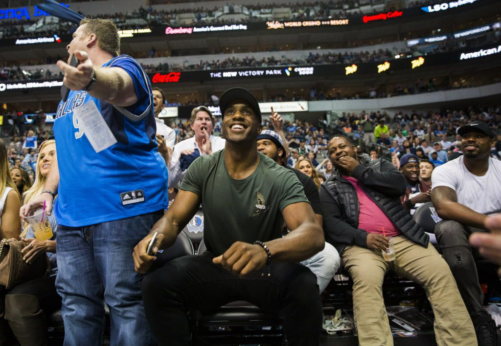 "Dallas Cowboys free safety Byron Jones, center, stands up as fans shout ""Romo, Romo"" during the fourth quarter of an NBA game between the Dallas Mavericks and the Denver Nuggets on Tuesday, April 11, 2017 at the American Airlines Center in Dallas. Former Dallas Cowboys quarterback Tony Romo was an honorary Mavericks team member. (Ashley Landis/The Dallas Morning News)"