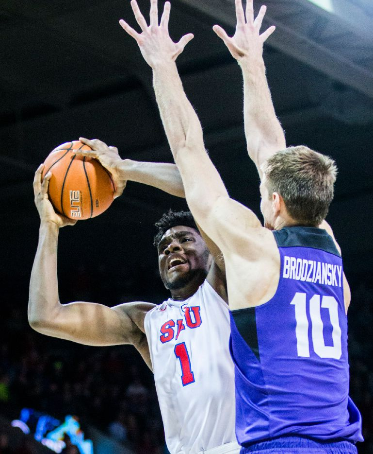 Southern Methodist Mustangs guard Shake Milton (1) goes up for a shot against TCU Horned Frogs forward Vladimir Brodziansky (10) during the second half of their game on Wednesday, December 7, 2016 at Moody Coliseum on the SMU campus in Dallas. (Ashley Landis/The Dallas Morning News)