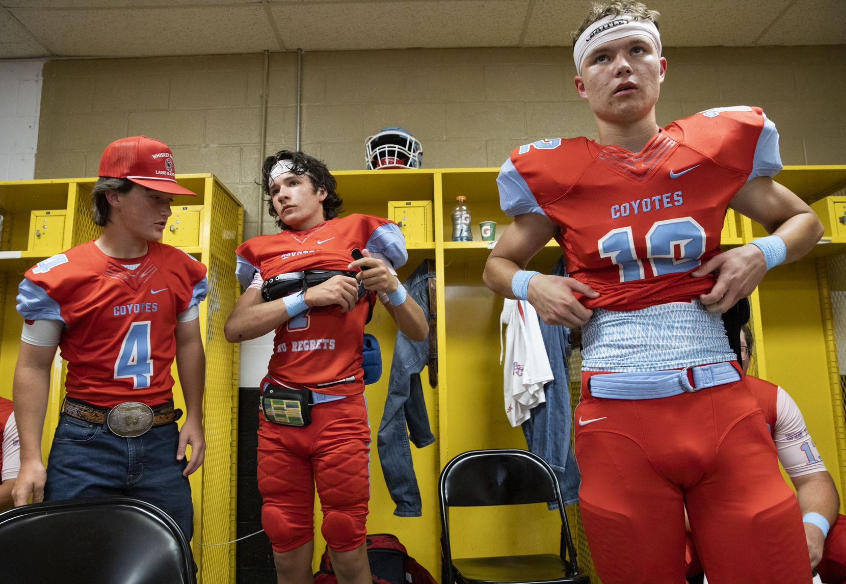 Borden County football players listen to coach Trey Richey in the locker room as they get ready to play against Calvert at Longhorn Stadium on Aug. 27, 2020 in Gordon.