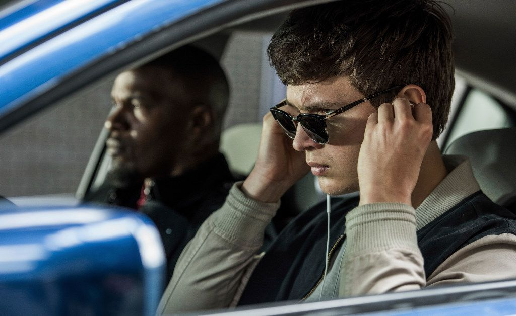 """Ansel Elgort, right, and Jamie Foxx in a scene from """"Baby Driver."""" With Baby's insistent belief that reality can be translated into Barry White lyrics and Brian May guitar solos, the lead character is an exaggerated surrogate for the young music fan of 2017."""