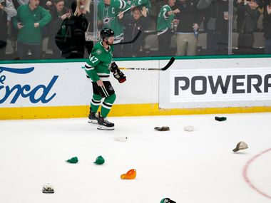Dallas Stars' Alexander Radulov (47) skates through hats tossed onto the ice after scoring on an empty net late in the third period of an NHL hockey game against the Minnesota Wild in Dallas, Tuesday, Oct. 29, 2019. The goal gave Radulov a hat trick in the 6-3 Stars win. (AP Photo/Tony Gutierrez)