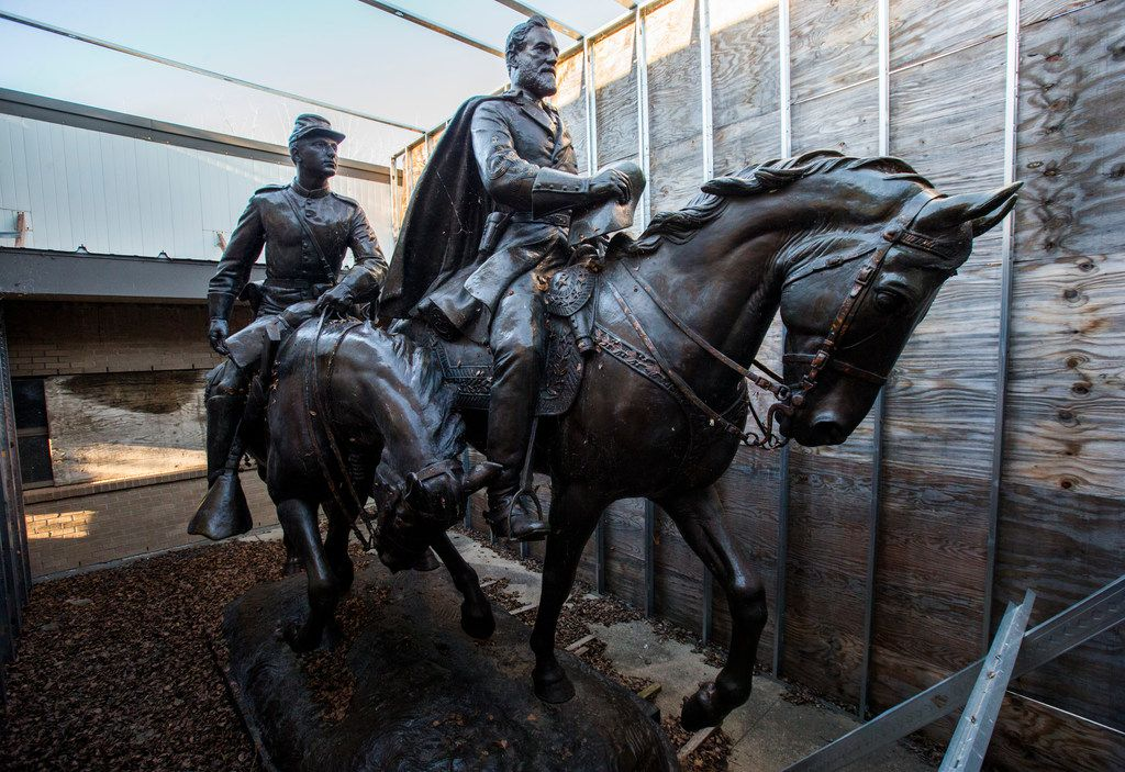 The 1935 statue of Robert E. Lee, right, and a young soldier by sculptor Alexander Phimister, sits in storage at Hensley Field, the former Naval Air Station on the west side of Mountain Creek Lake in Dallas. The buyer of the Lee statue for more than $1.4 million in a Dallas auction has been identified as a local law firm but the reason for the purchase still remains unclear. (Ashley Landis/The Dallas Morning News)