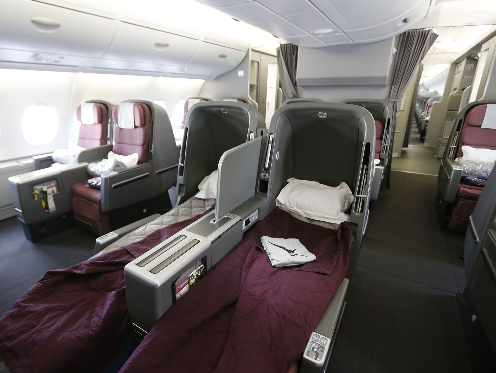This is the business class cabin in the Qantas A380-800 airplane where passengers can lie down with plenty of room.