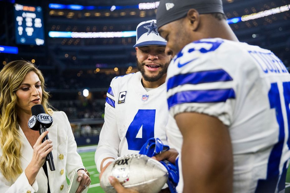 FILE - Cowboys quarterback Dak Prescott (4) presents wide receiver Amari Cooper (19) with the FOX Thanksgiving football after the Thanksgiving Day game against the Washington Redskins on Thursday, Nov. 22, 2018, at AT&T Stadium in Arlington. (Ashley Landis/The Dallas Morning News)