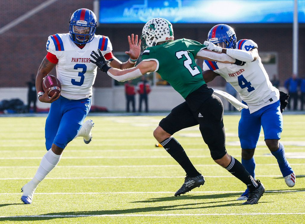 Duncanville wide receiver Zeriah Beason (4) provides cover for quarterback Ja'Quinden Jackson (3) as he breaks past Southlake Carroll defensive back Dylan Thomas (2) during the first half of a Class 6A Division I Region I high school football matchup between Southlake Carroll and Duncanville on Saturday, Dec. 7, 2019 at McKinney ISD Stadium in McKinney, Texas. (Ryan Michalesko/The Dallas Morning News)