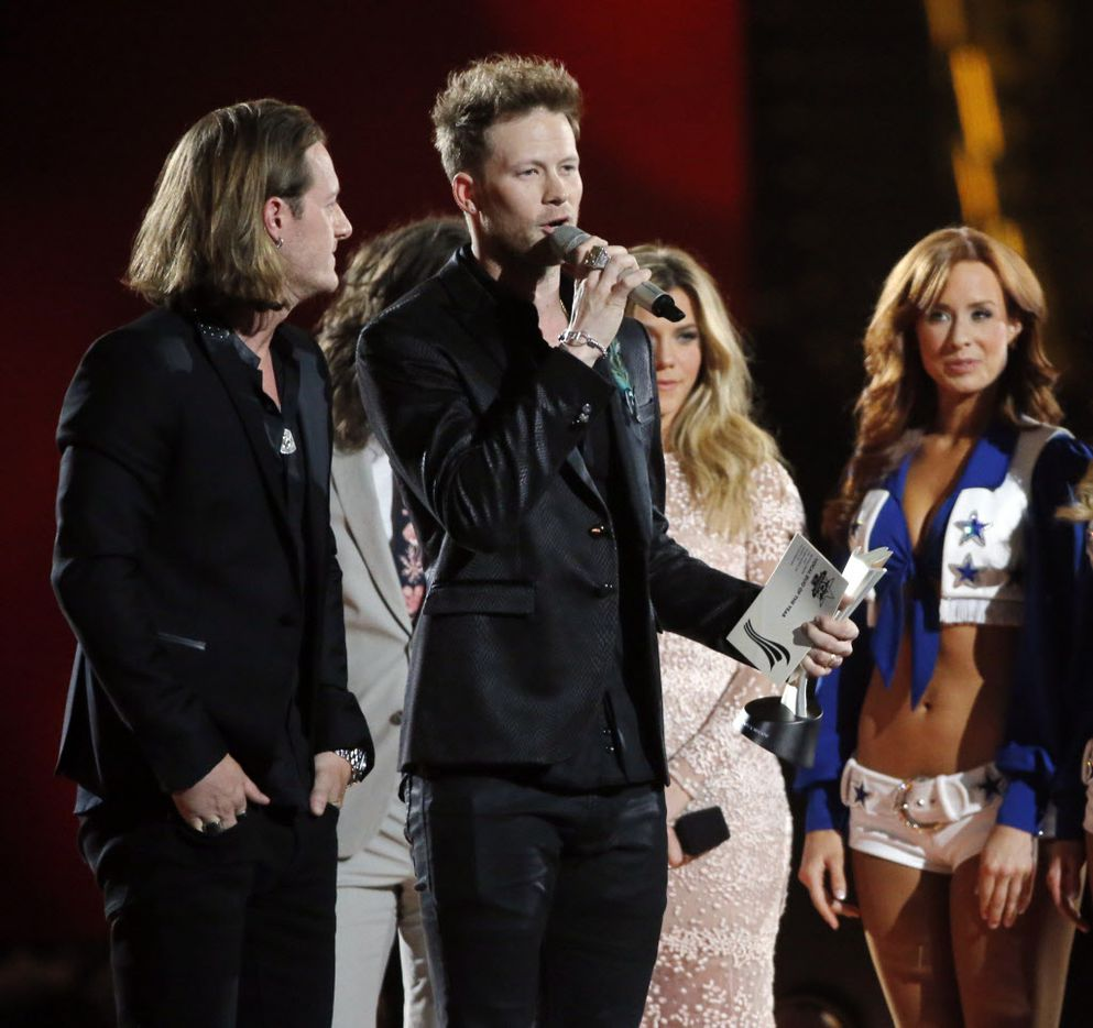 Tyler Hubbard (left) and Brian Kelley of Florida Georgia Line accept the award for vocal duo of the year during the 2015 Academy of Country Music Awards Sunday, April 19, 2015 at AT&T Stadium in Arlington, Texas.