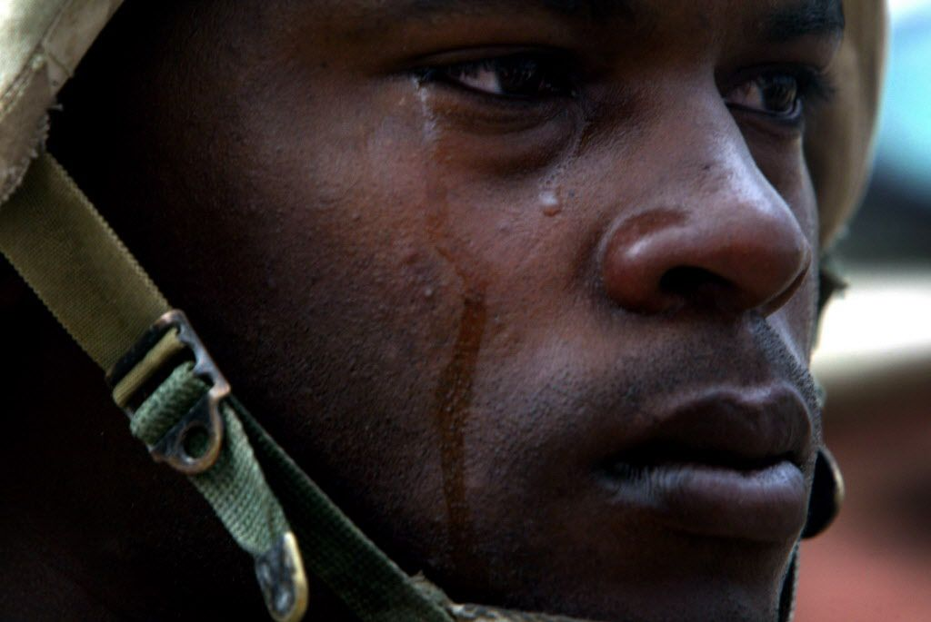 One of the Pulitzer Prize-winning photographs taken by David Leeson of The Dallas Morning News. Task Force 2-69 Armor, 3rd Brigade Combat Team, 3rd Infantry Division from Fort Benning Georgia: SSG. Lonnie Roberts cries at a memorial service in Baghdad for PV2 Gregory R. Huxley Jr., 19, of Forest Port, NY who was killed in action April 6th when the armored personnel carrier he was riding in was hit by a rocket propelled grenade. Huxley had just finished basic training five months earlier. Roberts was the squad leader and was riding in the carrier at the time of the incident. He is a member of 317 Engineer Battalion, 2nd Platoon Bravo Company