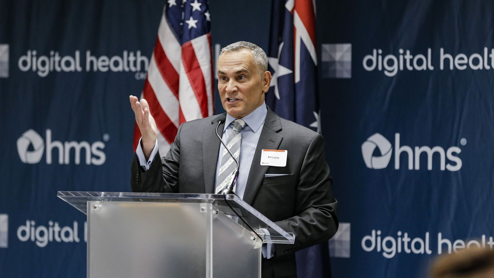 HMS chairman and CEO Bill Lucia spoke at a news conference last year to announce a partnership with researchers at Stanford and SMU to fight opioid addiction, hospital readmittance and other challenges that drive up health care costs.