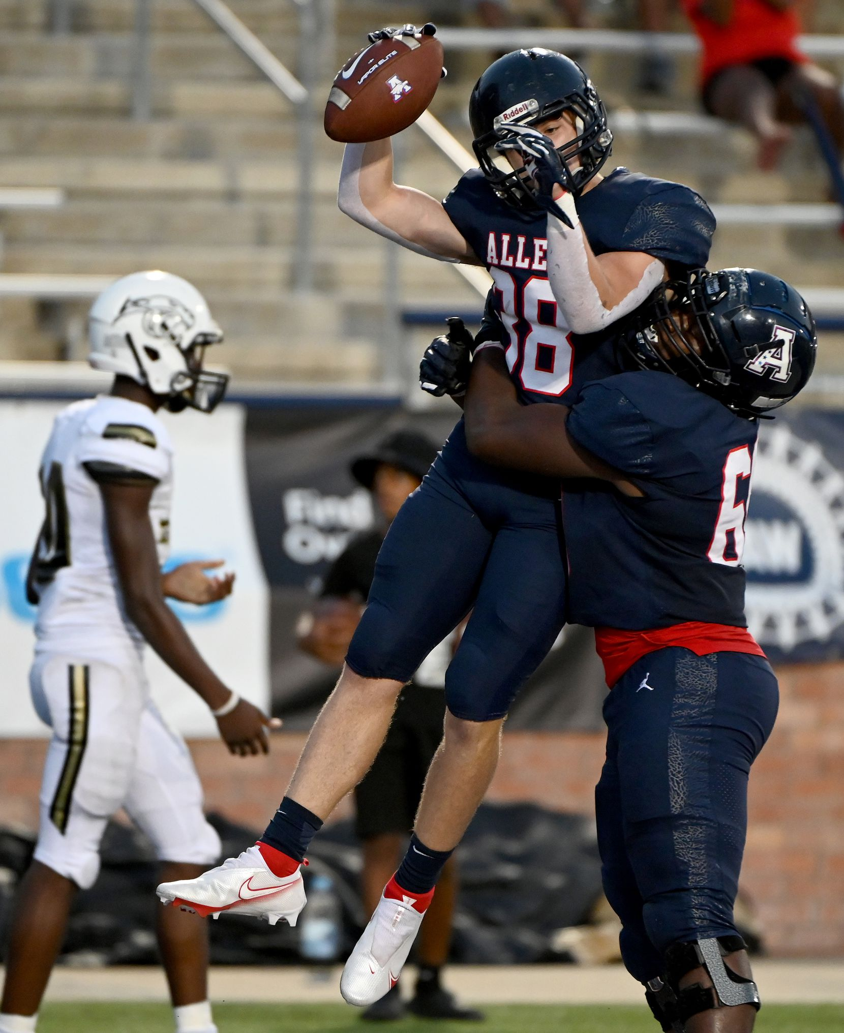 Allen's Brennan Harvey (38) and Antony Harris celebrate a touchdown in the first half during a high school football game between Plano East and Allen, Friday, Aug. 27, 2021, in Allen, Texas. (Matt Strasen/Special Contributor)