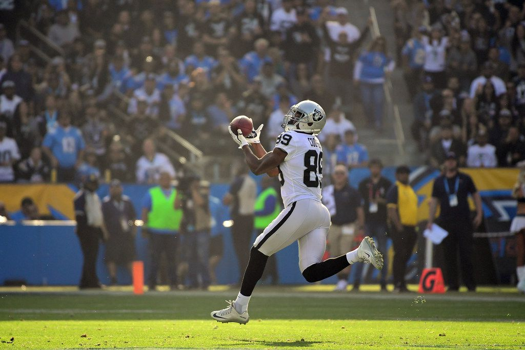 CARSON, CA - DECEMBER 31:  Amari Cooper #89 of the Oakland Raiders makes the 87 yard catch for a touchdown during the second quarter of the game against the Los Angeles Chargers at StubHub Center on December 31, 2017 in Carson, California.  (Photo by Harry How/Getty Images) ORG XMIT: 700070851