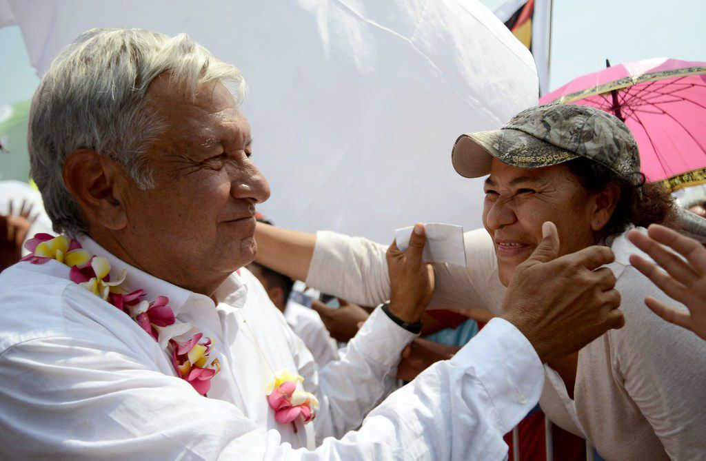 Mexico's presidential candidate for the MORENA party, Andres Manuel Lopez Obrador, known as AMLSO, greets supporters during a meeting at San Marcos community, in Guerrero State, Mexico on May 17, 2018. (AFP PHOTO / FRANCISCO ROBLES)