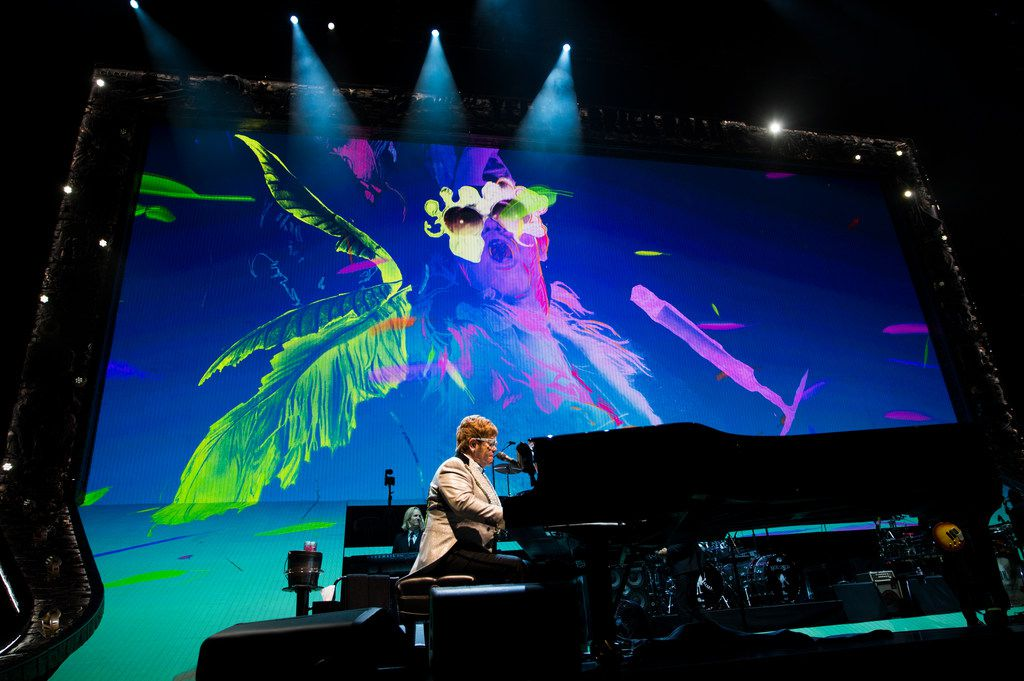 """Elton John performs """"Bennie and the Jets"""" at American Airlines Center in Dallas on Friday, December 14, 2018 during his Farewell Yellow Brick Road tour."""