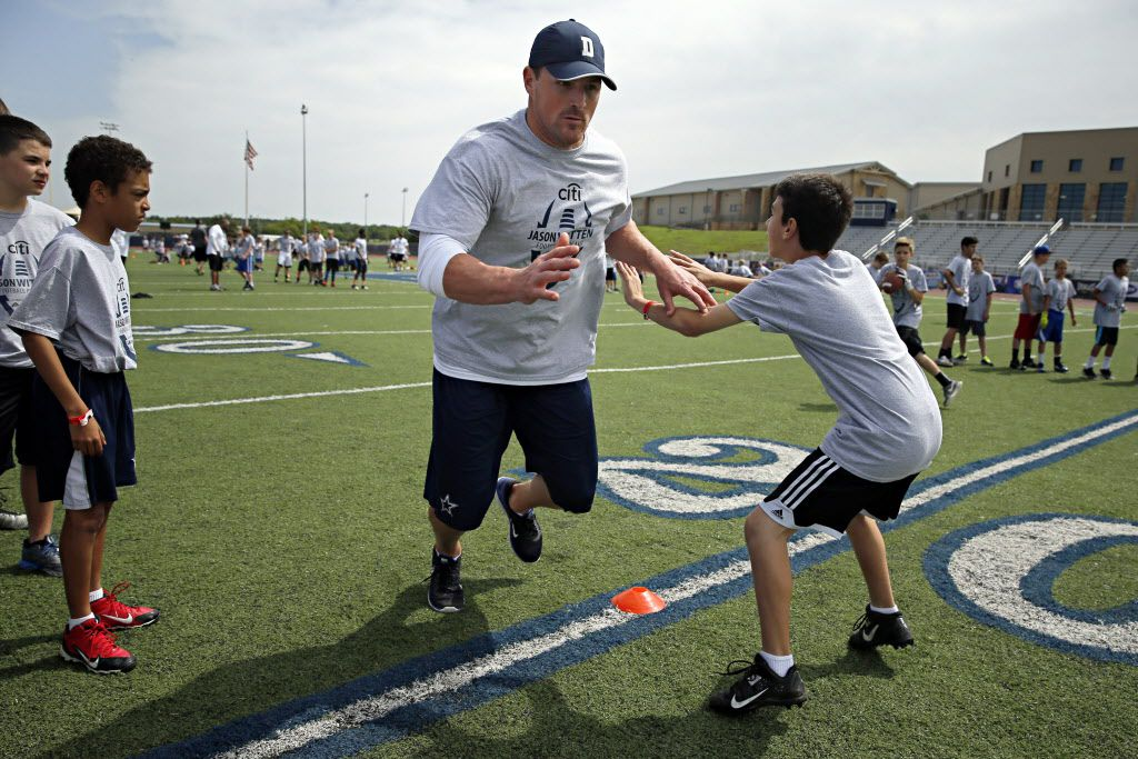 Kyle Hutcherson (right), 12, of Roanoke, Texas, tries to defend Dallas Cowboys tight end Jason Witten during the Jason Witten Youth Football Camp Sunday, May 17, 2015 at Liberty Christian School in Argyle, Texas. (G.J. McCarthy/The Dallas Morning News)