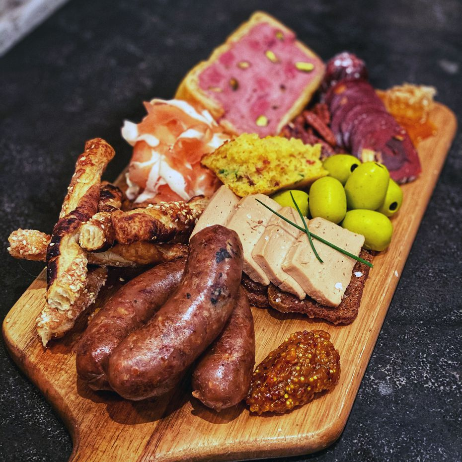 Yardbird's corporate executive pastry chef Jessica Scott makes an elaborate dessert charcuterie board. Customers might not know the salami isn't salami — until they take a bite and discover red velvet cookie dough inside.