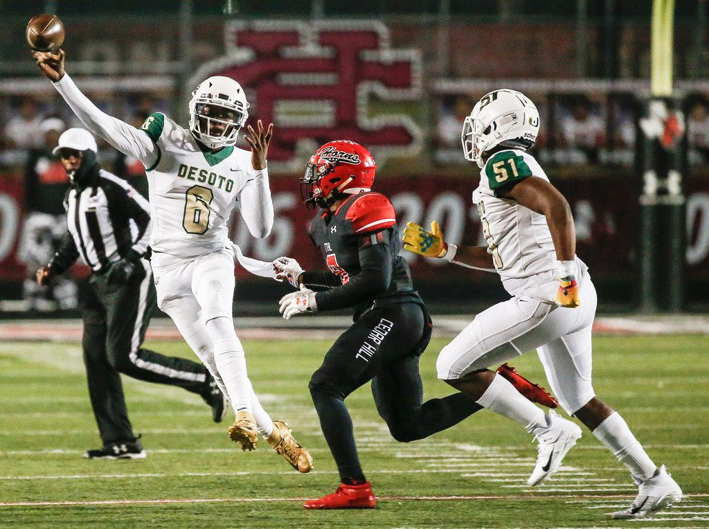 DeSoto quarterback Samari Collier fires off a pass over Cedar Hill linebacker Stefan Ingram (8) during a high school football match up between Cedar Hill and DeSoto on Thursday, Nov. 7, 2019. (Ryan Michalesko/The Dallas Morning News)