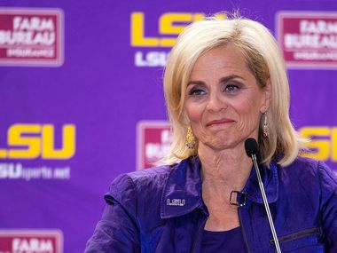New LSU women's basketball coach Kim Mulkey smiles during an introductory NCAA college basketball news conference for her at the Pete Maravich Assembly Center in Baton Rouge, La., Monday, April 26, 2021.