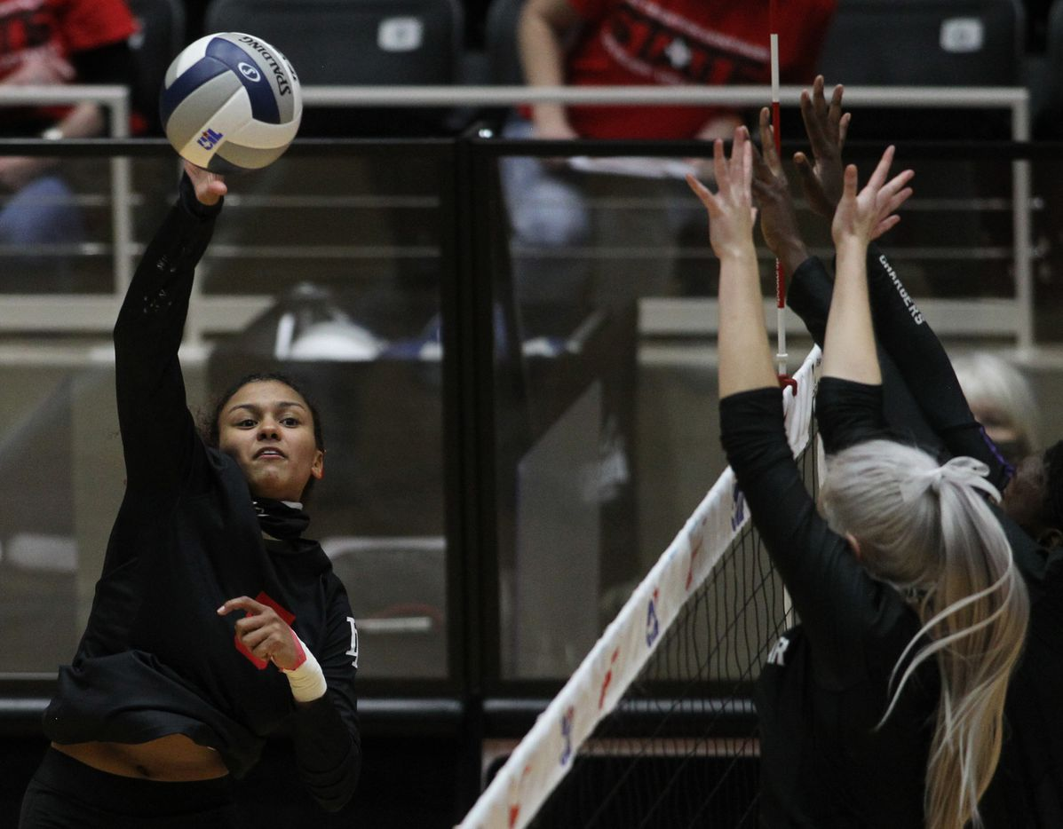 Lovejoy's Cecily Bramschreiber (5) directs a shot past a pair of Lamar Fulshear defenders during the final set of their match. The Leopards capped off a perfect season with a state title victory. The two teams played their Class 5A state championship volleyball match at Curtis Culwell Center in Garland on December 12, 2020. (Steve Hamm/ Special Contributor)