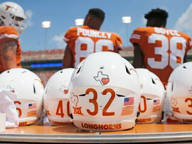 Every Texas Longhorns helmet sports a special decal showing support for the Houston area after it was damaged by flooding from Hurricane Harvey this week. Photographed during the University of Maryland Terrapins vs. the University of Texas Longhorns NCAA football game at Darrell K Royal Texas Memorial Stadium in Austin, Texas on Saturday, September 2, 2017. (Louis DeLuca/The Dallas Morning News)