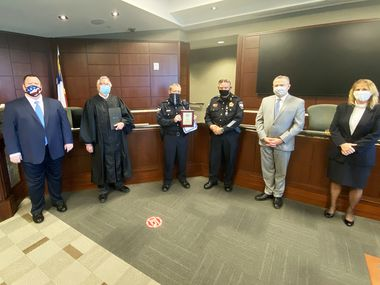 Lawrence Allen is awarded the 2020 Deputy Marshal of the Year award from the Mesquite municipal court. Allen and clerk  Thalia Guaida received recognition.